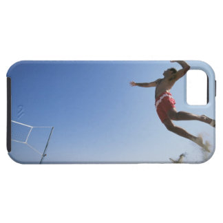 Male beach volleyball player jumping up to spike iPhone 5 cover