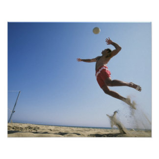 Male beach volleyball player jumping up to spike poster