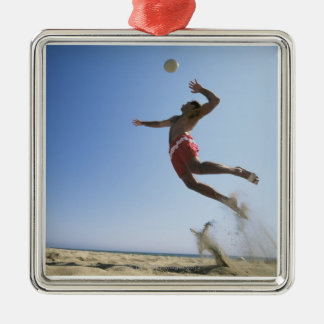 Male beach volleyball player jumping up to spike Silver-Colored square decoration