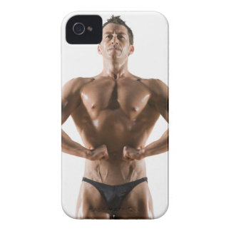 Male body builder flexing and posing Case-Mate iPhone 4 cases