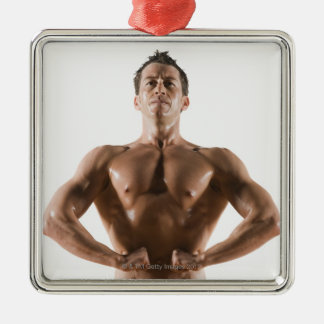 Male body builder flexing and posing christmas ornament