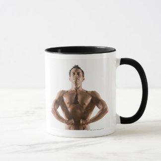 Male body builder flexing and posing mug