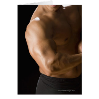 Male bodybuilder flexing muscles, front view, 2 card