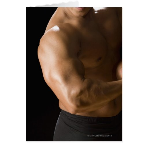Male bodybuilder flexing muscles, front view, 2 greeting card