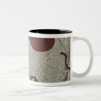 Male figure with the sun Two-Tone coffee mug