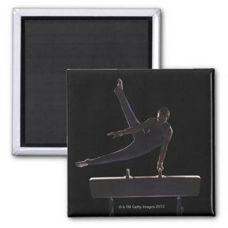 Male gymnast on pommel horse magnet