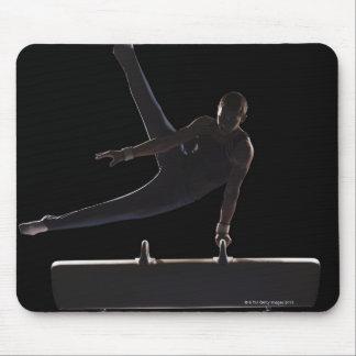 Male gymnast on pommel horse mouse mat
