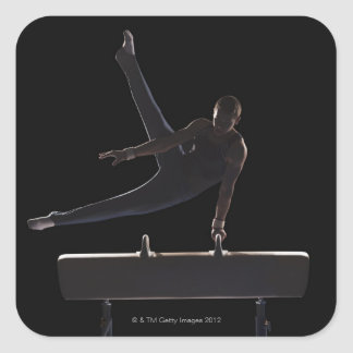Male gymnast on pommel horse square sticker