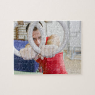Male gymnast on rings puzzles