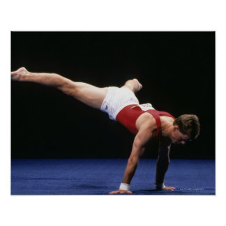 Male gymnast peforming a routine in the floor poster