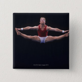 Male gymnast performing on the floor exercise 15 cm square badge