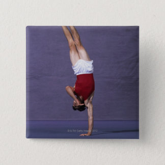 Male gymnast performing on the floor exercise 2 15 cm square badge