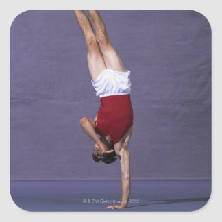 Male gymnast performing on the floor exercise 2 square sticker