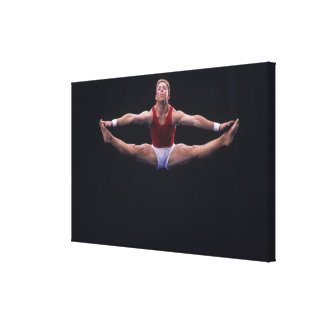 Male gymnast performing on the floor exercise canvas print