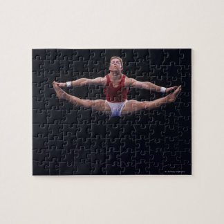 Male gymnast performing on the floor exercise puzzle