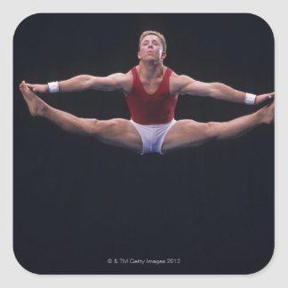 Male gymnast performing on the floor exercise square sticker