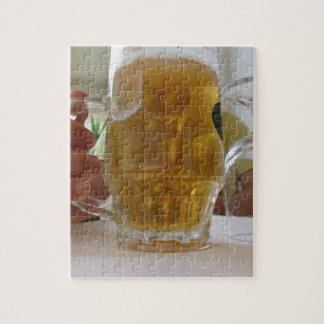Male hand holding a cold mug of light beer jigsaw puzzles
