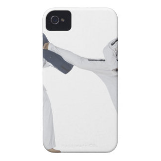 Male karate instructor teaching martial arts to 2 iPhone 4 cases