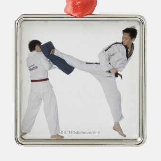 Male karate instructor teaching martial arts to 2 Silver-Colored square decoration