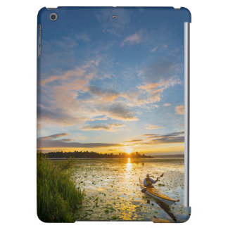Male kayaker paddling sea kayak on still water case for iPad air