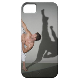 Male martial artist performing kick, studio shot barely there iPhone 5 case