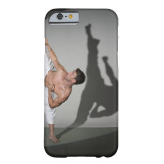 Male martial artist performing kick, studio shot barely there iPhone 6 case