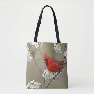 Male Northern Cardinal among pear tree Tote Bag