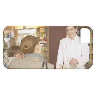 Male pharmacist handing medicine over to young case for the iPhone 5