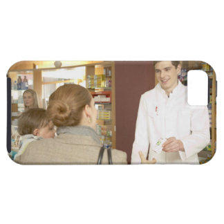 Male pharmacist handing medicine over to young iPhone 5 cover