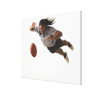 Male rugby player diving for ball canvas print