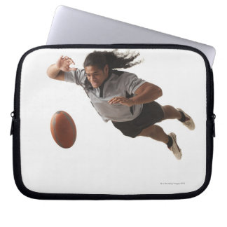 Male rugby player diving for ball laptop sleeve