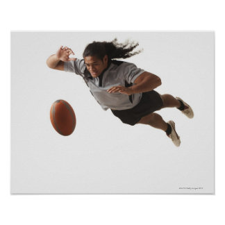 Male rugby player diving for ball poster