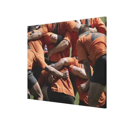 Male rugby players in scrum, rear view stretched canvas prints