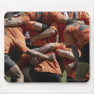 Male rugby players in scrum, rear view mouse mat