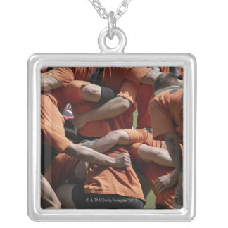 Male rugby players in scrum, rear view silver plated necklace
