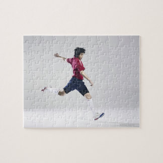 Male soccer player preparing to kick ball jigsaw puzzle