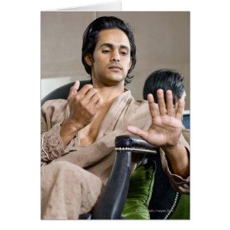 Man admiring his manicure card
