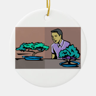 Man admiring two bonsai trees graphic round ceramic decoration