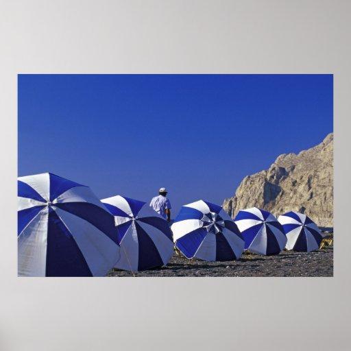 Man and  Beach Umbrellas, Santorini (Greece) Poster