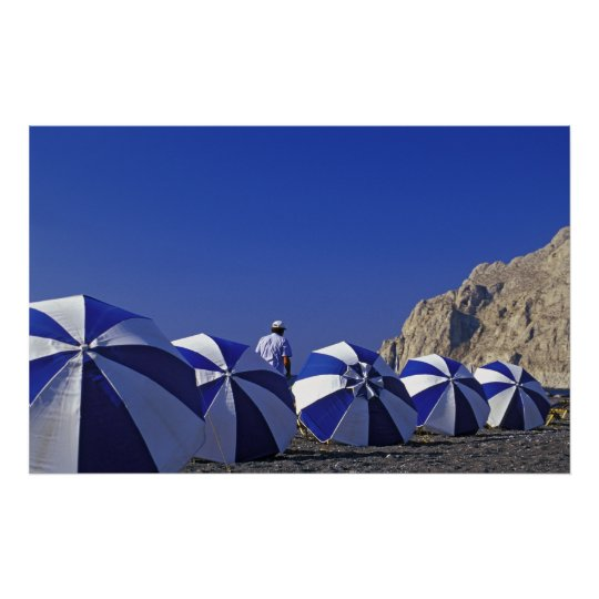 Man and  Beach Umbrellas, Santorini (Greece) Poster