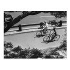 Man and Boy Cycling Postcard
