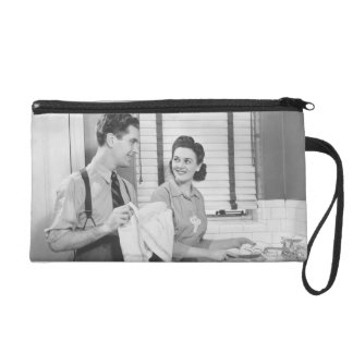 Man and Woman Doing Dishes Wristlet Purses