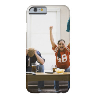 Man and woman sitting on sofa watching football barely there iPhone 6 case