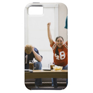 Man and woman sitting on sofa watching football iPhone 5 cases