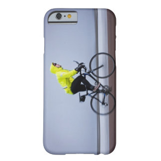 Man bicycles on a cold and foggy winter day. barely there iPhone 6 case