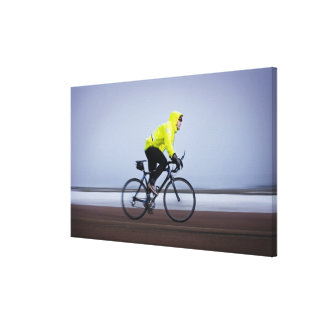 Man bicycles on a cold and foggy winter day. canvas print