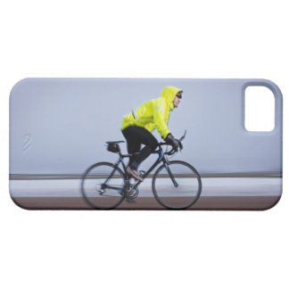 Man bicycles on a cold and foggy winter day. iPhone 5 case