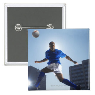 Man bouncing soccer ball on his head 15 cm square badge