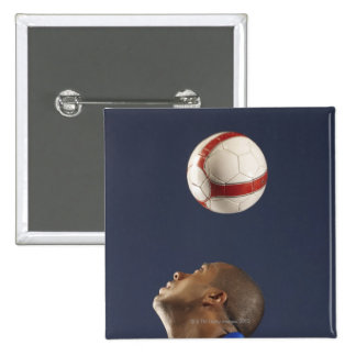 Man bouncing soccer ball on his head 2 15 cm square badge
