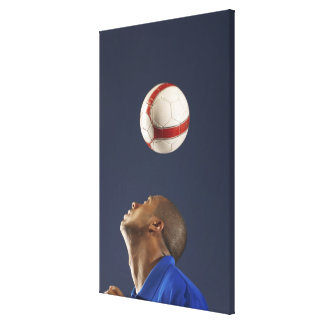 Man bouncing soccer ball on his head 2 canvas print